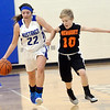 WARREN DILLAWAY / Star Beacon<br /> ALEXIS CASSESA (left) of Grand Valley is fouled by Hannah Lewandowski of Newbury (10) on Monday night in Orwell.