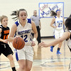 WARREN DILLAWAY / Star Beacon<br /> JESSICA VORMELKER of Grand Valley (12) drives to the basket with Ashley Wakely (14) of Newbury defending  and Black Knight teammate Hannah Lewandowski following the play on Monday night in Orwell.