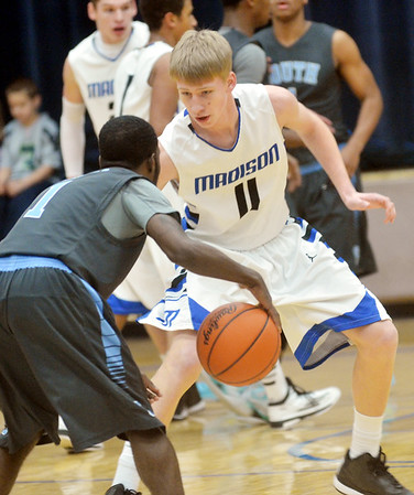 WARREN DILLAWAY / Star Beacon<br /> ANTHONY CORBIN (11) of Madison defends Jemille Coleman of Willoughby South  on Tuesday night at Madison.