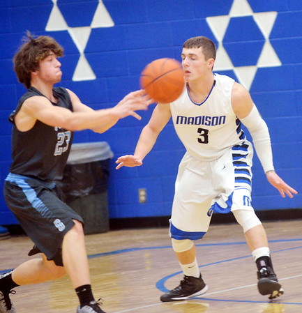 WARREN DILLAWAY / Star Beacon<br /> NICK LAW of Madison (3) defends Jack Whitaker of Willoughby South on Tuesday night at Madison.