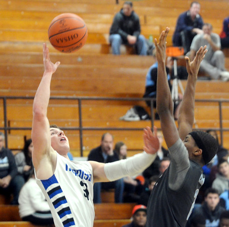 WARREN DILLAWAY / Star Beacon<br /> NICK LAW (3) of Madison shoots over  Doug Burks  (right) of Willoughby South on Tuesday night at Madsion.