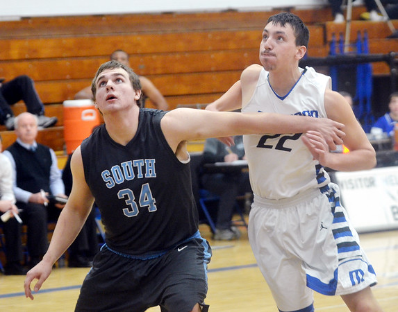 WARREN DILLAWAY / Star Beacon<br /> CHASE PETTI (22)  of Madison battles for position with DAN DANFORD (34) of  Willoughby South on Tuesday night at Madison.