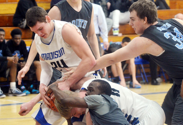 WARREN DILLAWAY / Star Beacon<br /> VINCE PRIMER (24) and Madison teammate Anthony Corbin (11) battle for the ball with Jemille Coleman (foreground middle) of Willoughby South as Rebel Jacob Shafer (34) tries to get the ball on Tuesday night at Madison.