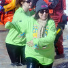 WARREN DILLAWAY / Star Beacon<br /> A PARTICIPANT in the  Polar Bear Plunge, held Saturday at Geneva State Park, prepares to slaps hands with a dive team member. The event raised an estimated $90,000 for Special Olympics Ohio.