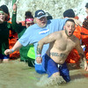 WARREN DILLAWAY / Star Beacon<br /> TONY GROYS of Cleveland (no shirt) reacts to the cold water on Saturday at the Polar Bear Plunge at Geneva State Park. The event raised an estimated $90,000 for Special Olympics Ohio.