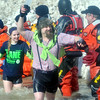 """WARREN DILLAWAY / Star Beacon<br /> JOE GALLAGHER of Erie carries an ice """"torch"""" during the Polar Bear Plunge held Saturday at Geneva State Park. The event raised an estimated $90,000 for Special Olympics Ohio."""