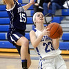 WARREN DILLAWAY / Star Beacon<br /> ABBY TRISKETT (23) of Grand Valley drives to the basket as Amanda Tishman of Rootstown tries to block the shot on Saturday at Grand Valley during a Division III sectional championship game.