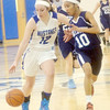 WARREN DILLAWAY / Star Beacon<br /> JESSICA VORMELKER (12) of Grand Valley dribbles down court with Monique Jackson of Rootstown defending on Saturday during a Division III sectional championship game at Grand Valley.
