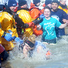 WARREN DILLAWAY / Star Beacon<br /> KAYLA CURTISS, a teacher at St. John School, trips during the    Polar Bear Plunge on Saturday at Geneva State Park. The event raised an estimated $90,000 for Special Olympics Ohio.