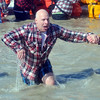 WARREN DILLAWAY / Star Beacon<br /> KEITH SULZER of the Cleveland Police Department reacts to the cold water during  the  Polar Bear Plunge held Saturday at Geneva State Park. The event raised an estimated $90,000 for Special Olympics Ohio.