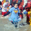 WARREN DILLAWAY / Star Beacon<br /> A TUTU clad participant in the  Polar Bear Plunge held Saturday at Geneva State Park slaps hands with a dive team member. The event raised an estimated $90,000 for Special Olympics Ohio.