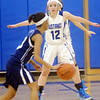 WARREN DILLAWAY / Star Beacon<br /> JESSICA VORMELKER (12) of Grand Valley defends Monique Jackson of Rootstown on Saturday during a Division III sectional championship game at Grand Valley.