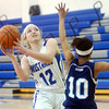 WARREN DILLAWAY / Star Beacon<br /> JESSICA VORMELKER (12) of Grand Valley gets fouled by Monique Jackson of Rootstown on Saturday during a Division III sectional championship game at Grand Valley.