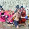 WARREN DILLAWAY / Star Beacon<br /> BRIAN STILLINGS of Wickliffe (not shirt) leads a group of participants in the Polar Bear Plunge on Saturday at Geneva State Park. The event raised an estimated  $90,000 for Special Olympics Ohio.
