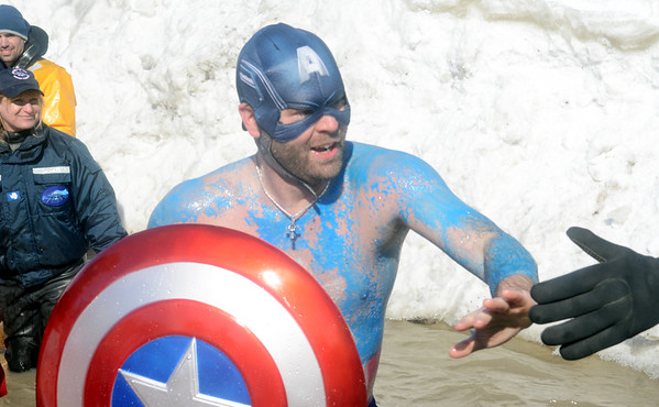 WARREN DILLAWAY / Star Beacon<br /> STEVE POTTS of North Ridgeville became Captain America during the Polar Bear Plunge at Geneva State Park on Saturday afternoon. The event raised an estimated $90,000 for Special Olympics Ohio.