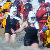 WARREN DILLAWAY / Star Beacon<br /> PARTICIPANTS IN the  Polar Bear Plunge, held Saturday at Geneva State Park, slaphands with dive team members. The event raised an estimated $90,000 for Special Olympics Ohio.