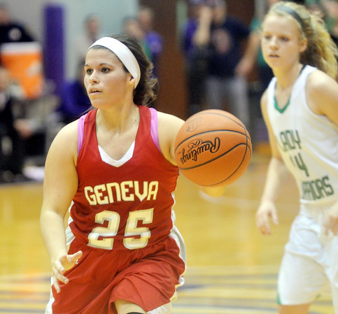 WARREN DILLAWAY / Star Beacon<br /> COURTNEY HARRIMAN (25) of Geneva looks to pass as Melinda Trimmer (14) of West Branch follows the play on Saturday during a Division II regional final at Barberton.