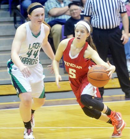 WARREN DILLAWAY / Star Beacon<br /> EMILY HARRIMAN (5) of Geneva drives to the basket with Lea Bock (44) of West Branch defending on Saturday during a Division II regional final at Barberton.