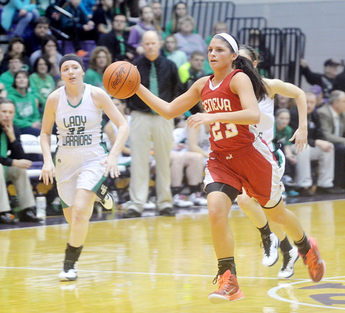 WARREN DILLAWAY / Star Beacon<br /> SARAH JUNCKER (23) of Geneva leads a fast break with Paige Welsh (32) in hot pursuit during a Division II regional final on Saturday afternoon in Barberton.