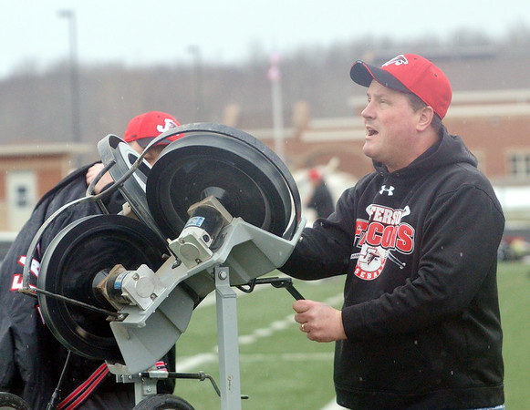 WARREN DILLAWAY / Star Beacon<br /> SCOTT BARBER, Jefferson baseball coach, uses a pop fly machines for outfield practice on Monday at Falcon Stadium in Jefferson.