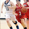 WARREN DILLAWAY / Star Beacon<br /> JESSICA BECKER (3) of Jefferson dribbles up court with Angela Cole of Conneaut (left) in hot pursuit on Tuesday night during the Star Beacon Ed Batanian Senior Classic at Jefferson High School.