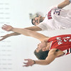 WARREN DILLAWAY / Star Beacon<br /> ZACH BUESCHER (left) of Perry jumps with Eli Kalil of Edgewood on Tuesday night to start the Star Beacon Ed Batanian Senior Classic at Jefferson High School.