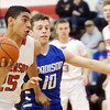 WARREN DILLAWAY / Star Beacon<br /> JAMES JACKSON (25) of Jefferson drives to the basket with Aaron Petruccelli (10) of Madison close behind during the Star Beacon Ed Batanian Senior Classic onTuesday night at Jefferson High School.