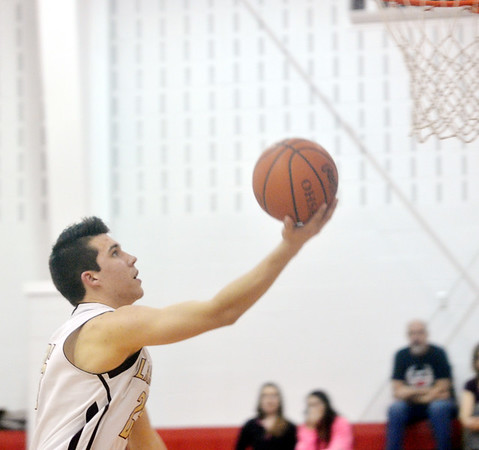 WARREN DILLAWAY / Star Beacon<br /> CHASE THURBER of Pymatuning Valley drives to the basket  during the Star Beacon Ed Batanian Senior Classic on Tuesday night at Jefferson High School.