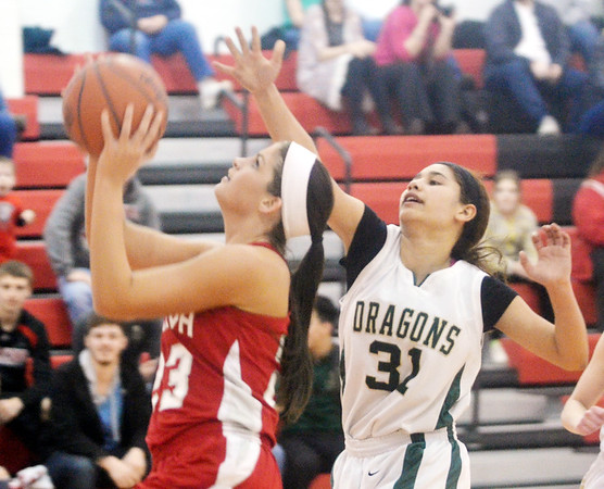 WARREN DILLAWAY / Star Beacon<br /> SARAH JUNCKER (with ball) of Geneva drives to the basket with Kay Cruz of Lakeside (31) close behind during the Star Beacon Ed Batanian Senior Classic on Tuesday night at Jefferson High School.
