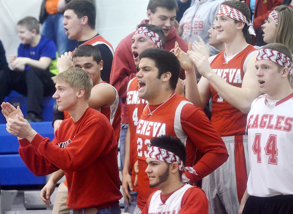 WARREN DILLAWAY / Star Beacon<br /> GENEVA GIRLS basketball fans get fired up during a Division II district semifinal game against Glenville on Monday evening in Grand Valley.