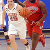 WARREN DILLAWAY / Star Beacon<br /> MADELINE BEAN (25) of Jeffersondribbles uyp dcourt with Bronte Adams following on Monday night during a Division II district semifinal game at Grand Valley.
