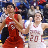 WARREN DILLAWAY / Star Beacon<br /> ANGELINE SEAMES (20) of Geneva battles for position with Martece Adams of Glenville on Monday evening during a Division II district semifinal game at Grand Valley.