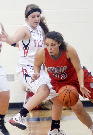 WARREN DILLAWAY / Star Beacon<br /> SHAYLA RAMOS (23) of Edgewood tries to find a place to dribble while Madeline Bean of Jefferson defends on Monday night during a Division II district semifinal game at Grand Valley.