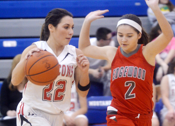 WARREN DILLAWAY / Star Beacon<br /> DEANNA COMP (22) of Jefferson looks for a place to drive  as Ashley Evans of Edgewood defends on Monday night during a Division II districe semifinal game at Grand Valley.