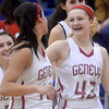 WARREN DILLAWAY / Star Beacon<br /> ALEX SCHAFER (43) celebrates with Geneva teammate Lindsey Mayle (left) after winning a Division II district semifinal game against Glenville on Monday evening in Grand Valley.