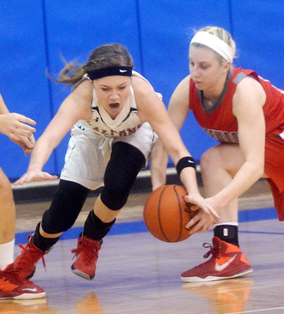 WARREN DILLAWAY / Star Beacon<br /> ANGELA SACK of Jefferson (left) battles for the ball with Taylor Diemer of Edgewood on Monday evening during a Division II district semifinal game at Grand Valley.