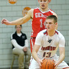 WARREN DILLAWAY / Star Beacon<br /> ZAC SWEAT (14) of Geneva defends Mason Lilja of Edgewood on Tuesday night during a Division II sectional semifinal game at Edgewood.