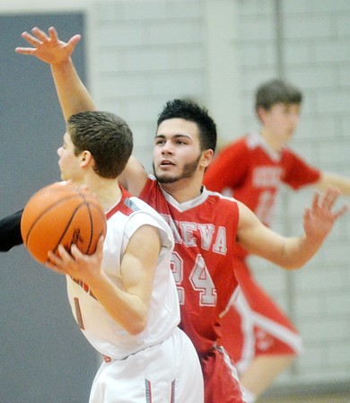 WARREN DILLAWAY / Star Beacon<br /> FELIX RIVERA (24) of Geneva defends Mitchell Dragon of Edgewood on Tuesday night during a Division II sectional semifinal game at Edgewood.