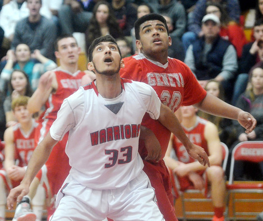 WARREN DILLAWAY / Star Beacon<br /> ELI KALIL of Edgewood blocks out Trayvon Miller of Edgewood on Tuesday night during a Division II sectional semifinal game at Edgewood.
