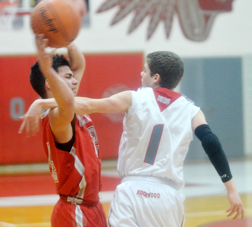 WARREN DILLAWAY / Star Beacon<br /> FELIX RIVERA (left) of Geneva tries to keep the ball from Mitchell Dragon  of Edgewood on Tuesday night during a Division II sectional semifinal game at Edgewood.