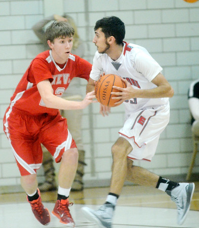 WARREN DILLAWAY / Star Beacon<br /> PAUL HITCHCOCK (left) of Geneva defends Eli Kalil of Edgewood on Tuesday night during a Division II sectional semifinal game at Edgewood.