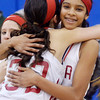 WARREN DILLAWAY / Star Beacon<br /> HAILEY PEOPLES (facing) of Geneva gets a hug from teammate Jamie Bradbury (33) after defeating Jefferson to win the Division II district championship on Thursday night in Orwell.
