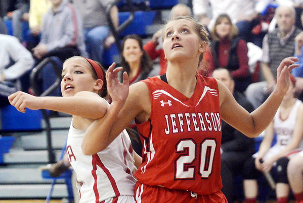 WARREN DILLAWAY / Star Beacon<br /> LINDSEY MAYLE of Geneva (left) battles for  position with Raquel Pularz of Jefferson (20) during the Division II District championship game at Grand Valley on Thursday evening.