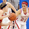 WARREN DILLAWAY / Star Beacon<br /> COURTNEY HARRIMAN (25) of Geneva defends Emily Smock of Jefferson on Thursday night during the Divsion II District championship game at Grand Valley.