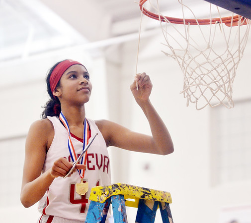 WARREN DILLAWAY / Star Beacon<br /> KAILEY PEOPLES of Geneva cuts down the net after defeating Jefferson to win the Division II district championship on Thursday night in Orwell.