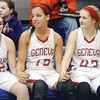 WARREN DILLAWAY / Star Beacon<br /> MEMBERS OF the Geneva girls basketball team (from left) Shayla Cross, Lindsey Mayle, Alex Schafer and Hailey Peoples holds hands after defeating Jefferson to win the Division II District Championship at Orwell.