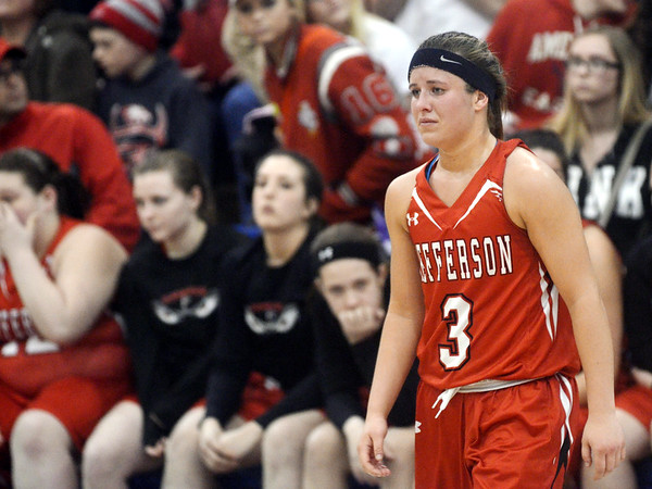 WARREN DILLAWAY / Star Beacon<br /> JESSICA BECKER of Jefferson prepares to get  her runner-up medal on Thursday after losing the Division II District championship game at Grand Valley.