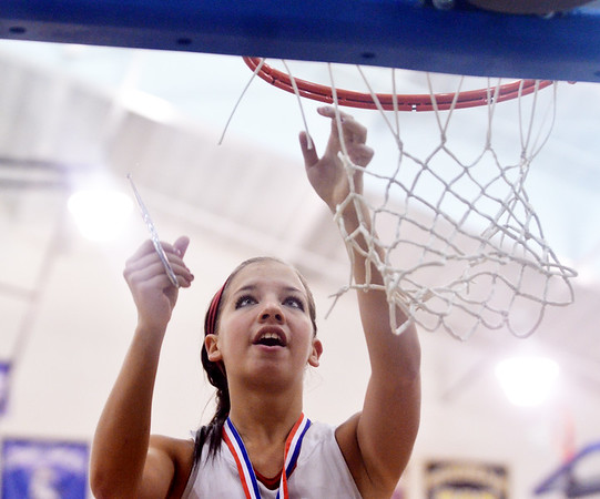 WARREN DILLAWAY / Star Beacon<br /> LINDSEY MAYLE of Geneva cuts down the net after defeating Jefferson to win the Division II district championship on Thursday night in Orwell.