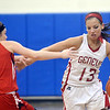 WARREN DILLAWAY / Star Beacon<br /> LINDSEY MAYLE (13) of Geneva drives to the basket as Emily Smock of Jefferson (1) defends on Thursday night during the Division II District championship game at Grand Valley.