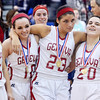 WARREN DILLAWAY / Star Beacon<br /> MEMBERS of the Geneva girls basketball team (from left) Courtney Harriman, Rachael Harrington, Sarah Juncker and Angeline Seames celebrate after defeating Jefferson to win the Division II district championship on Thursday night in Orwell.
